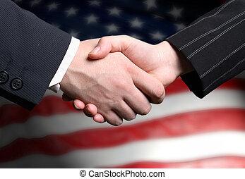 hand schud, en, een, amerikaanse vlag, in, de, achtergrond