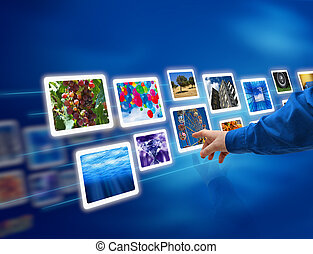 Male hand selecting images multimedia information flow
