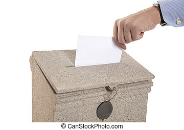 Hand sending a letter in a mail box