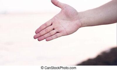 Hand shake as symbol of international friendship - Close-up...