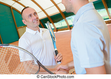 hand shake at the tennis court