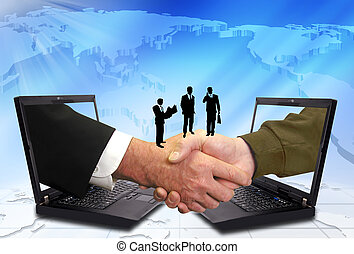 Hand shake between a businessman and a laptop