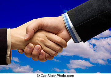 Hand shake - hand shake in front of a blue sky
