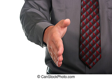 Hand shake - The businessman in a grey shirt and a tie gives...