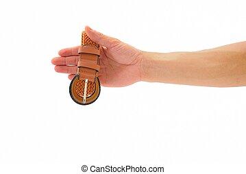 Hand show orange belt for woman