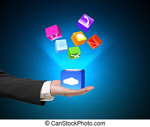 Hand showing cloud box illuminated app icons isolated on blue