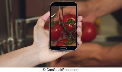 Hand showing cooking clips on smart