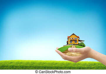 Hand showing House on the green field