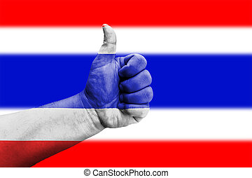 Hand showing thumbs up sign on flag of Thailand