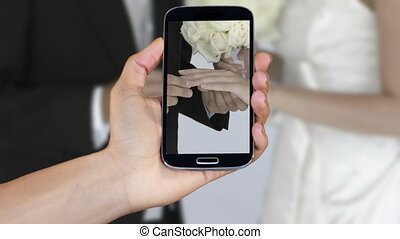 Hand showing wedding clips on smar