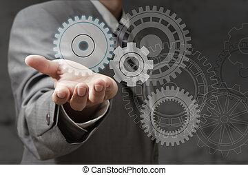 hand shows cogwheels as concept