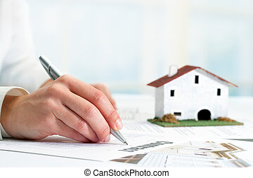 Hand signing real estate contract. - Extreme close up of...