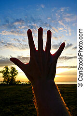 Hand Silhouette on Sunset