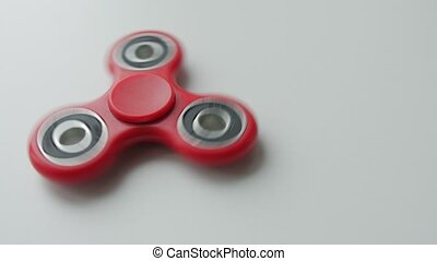Hand spinner with white background. - Red hand spinner with...