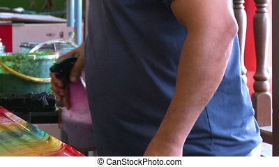 Hand-Spraying A Batik Textile, KL, Malaysia - Close-up low-...