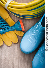Hand spraying rubber hose with spray nozzle leather safety glove