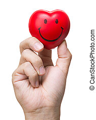 Hand squeezing stress ball in heart shape