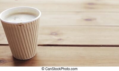 hand stirring sugar in cup of coffee
