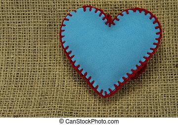 Hand stitched blue foam sheet toy heart on jute
