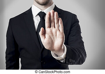 hand stop - man in suite holding hand stop