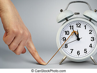 Hand stop time on alarm clock, deadline concept