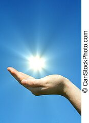 hand sun and blue sky with copyspace showing freedom or...
