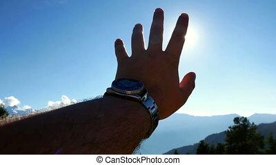 Hand sun hills mountains - Man hand touch sun beautiful...
