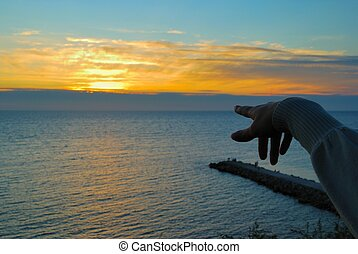 Hand, sunset