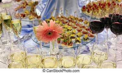 Hand take canape from appetizer table with champagne and...