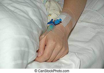 hand takes infustio - Womans hand on white hospitals bed
