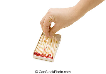 hand takes out a match from a matchbox