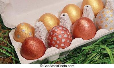 Hand takes the golden easter egg