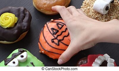 Hand takes the sweetness close up Donuts