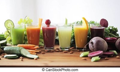 hand taking glass of vegetable juice from table