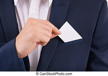 Hand taking out business card from of pocket.