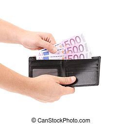 Hand taking out euro bills from purse.