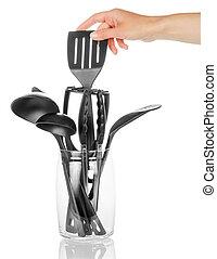 Hand taking spatula