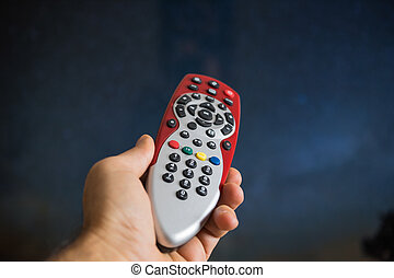 hand the television remote control.