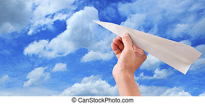 hand throwing paper plane to blue s