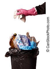 hand throwing rubbish in a trash bin