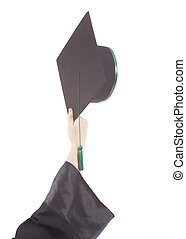hand throwing up graduation cap isolated on white