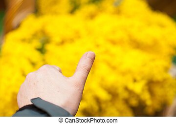hand thumb up on yellow