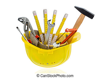 hand tool in a protective helmet, symbol photo for craft, construction, home improvement