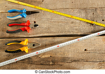 Hand tools for home repairs on the background of old wooden ...
