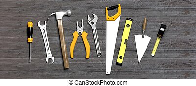 Hand tools on grey wooden background. 3d illustration