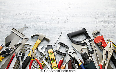hand tools - variety of tools on white textured background...