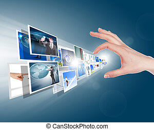 Hand touches the flow of images. Symbol of media streams