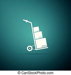 Hand truck and boxes icon isolated on green background. Dolly symbol. Flat design. Vector Illustration