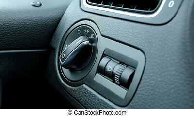 hand turn on light switch in car