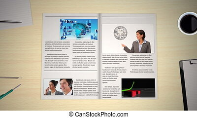 Hand turning pages of world news business magazine showing...